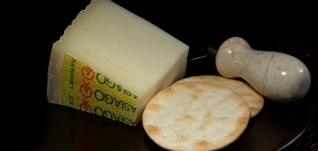 What does Asiago cheese taste like